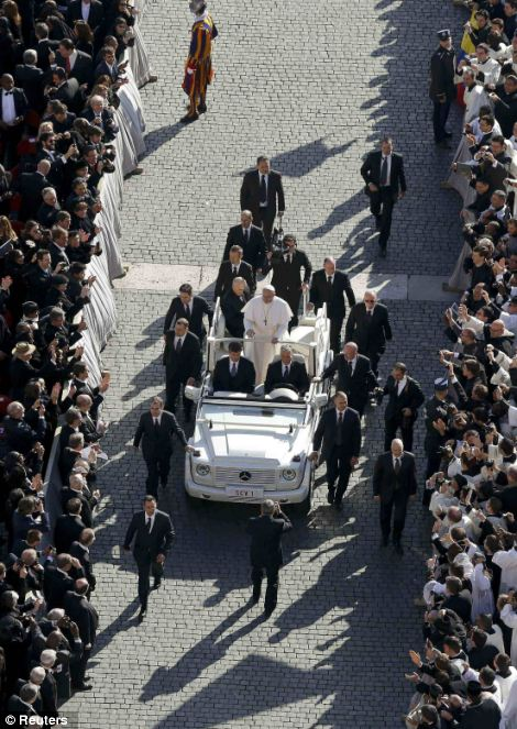 Pope Francis arrives in Saint Peter's Square for his inaugural mass