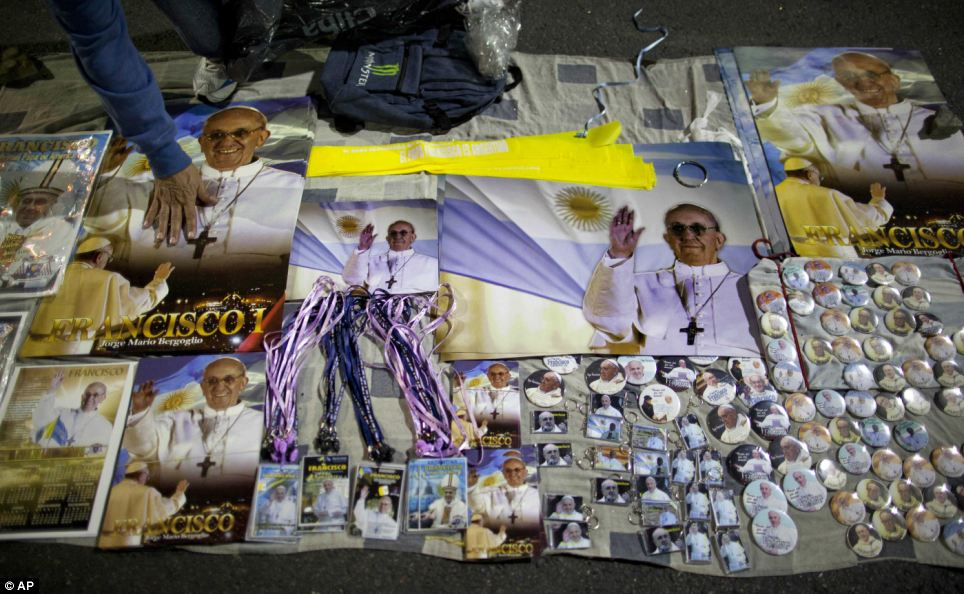 Memorabilia: A man sells posters and badges of Pope Francis outside the Metropolitan Cathedral before a live broadcast from the Vatican of his installation Mass in Buenos Aires
