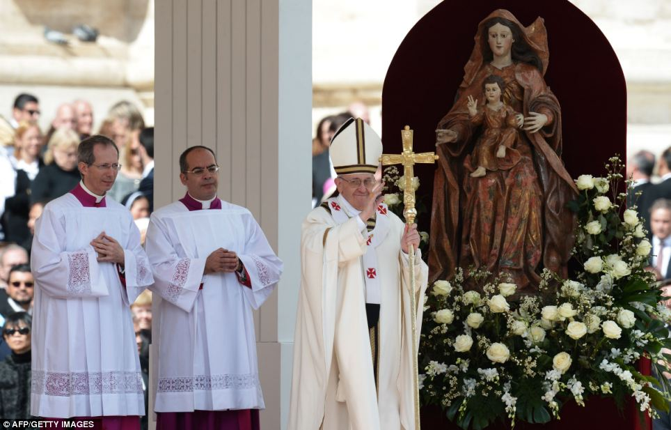 Welcomed: Pope Francis smiles widely during his inauguration mass