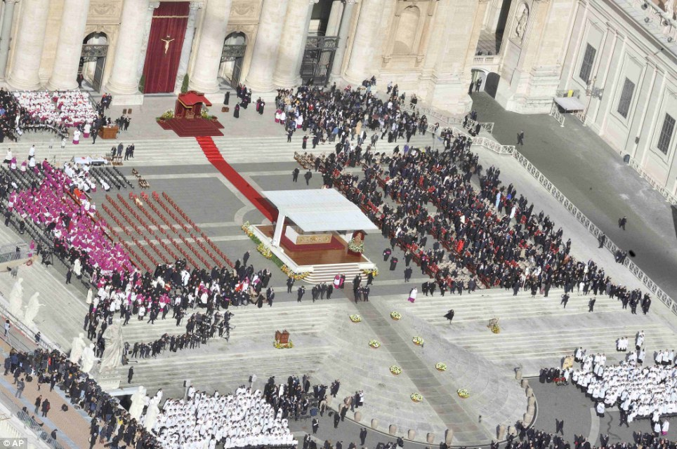 Spectacular start: An aerial view of Saint Peter's Square prior to the start of the installation Mass as the bishops, cardinals and VIP guests arrive