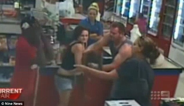 Panic: The girl's father Michael Narkle hold his head in his hands as his daughter fails to respond