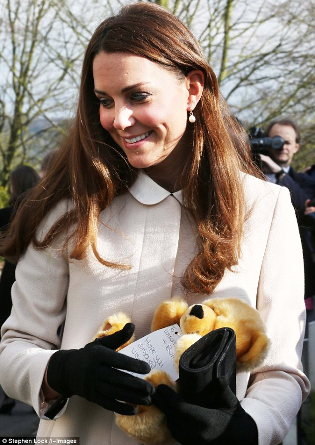 One teddy bear Kate received came with a card that read 'To William, Kate and Bump, Hope you enjoyed your visit'