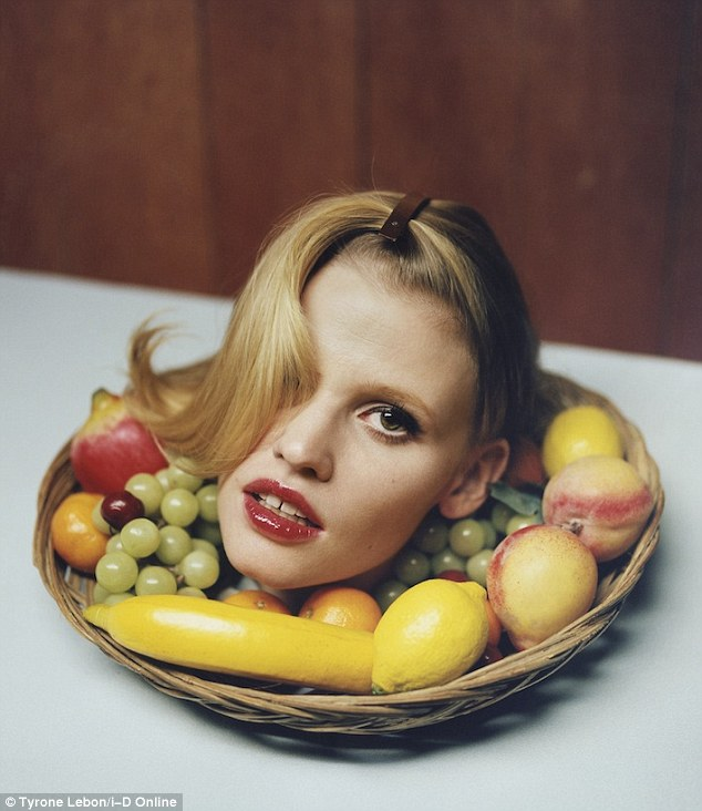 Fresh fruit: In another picture it is just Lara's head on show, placed in a bowl of fruit