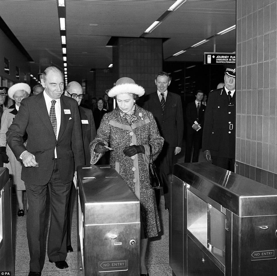 Down memory lane: Queen Elizabeth II pictured at Heathrow Central station in London when she officially opened the £30 million Piccadilly Line extension linking Heathrow Airport with London's underground railway system