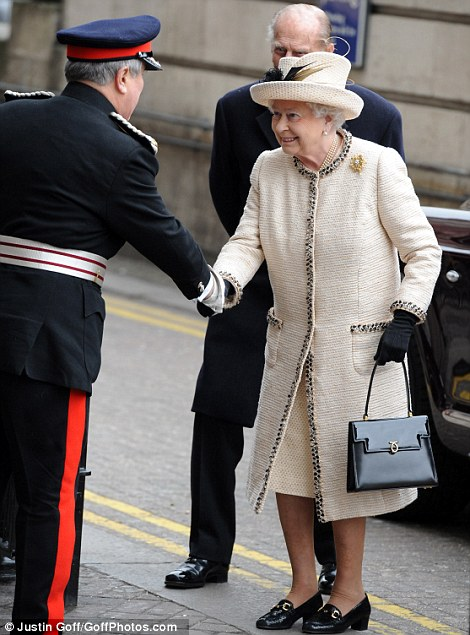 Back to her best: The Queen and the Duke of Edinburgh visit Baker Street tube station to celebrate the 150th anniversary of the network