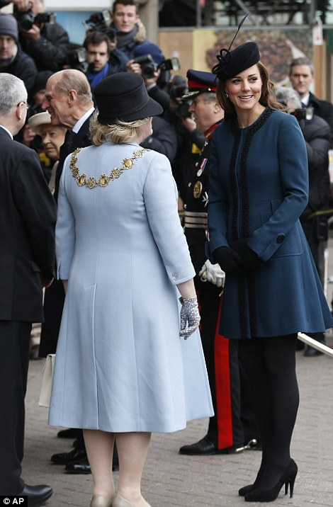 Being shown the ropes: The Duchess of Cambridge, right, accompanies Queen Elizabeth II and Prince Philip, to Baker Street underground station