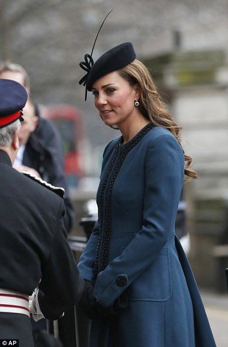 Keeping warm: The five-months pregnant Duchess of Cambridge kept warm in a thick coat and black gloves