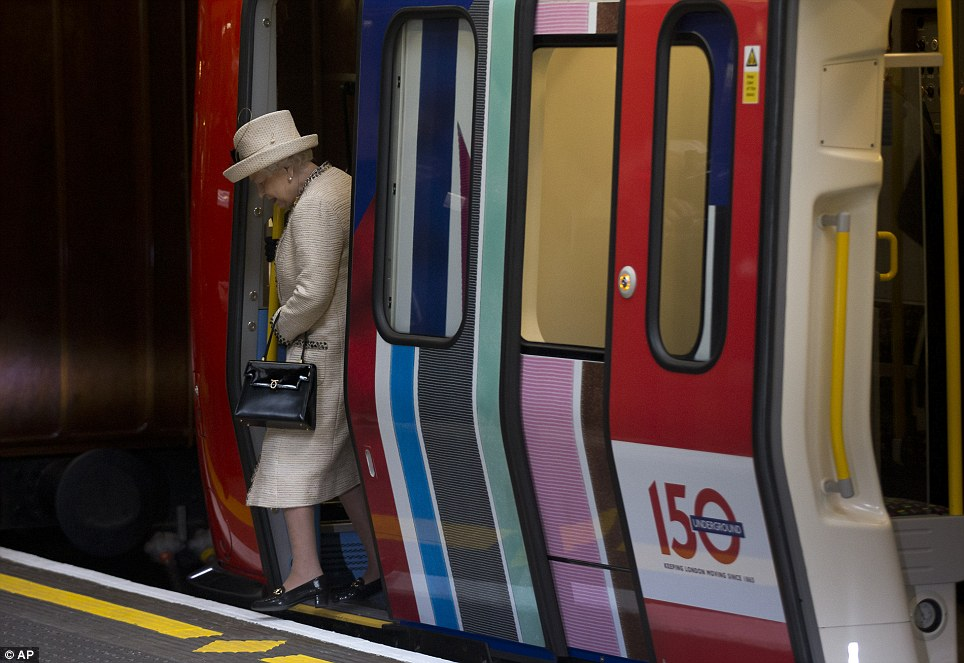 Disembark: Britain's Queen Elizabeth II steps off a parked train she was shown around at Baker Street station in London to mark the 150th anniversary of the London Underground