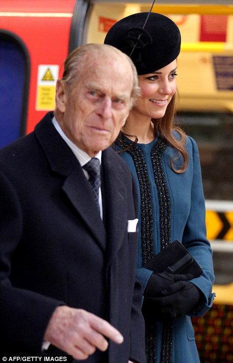 On track: The Duchess of Cambridge and Prince Philip wait together on a platform at Baker Street Station