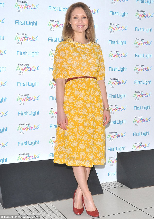 Ladylike: Myanna Buring opted for vintage elegance as she attended the 2013 First Light Awards at London's Odeon Leicester Square on Tuesday night