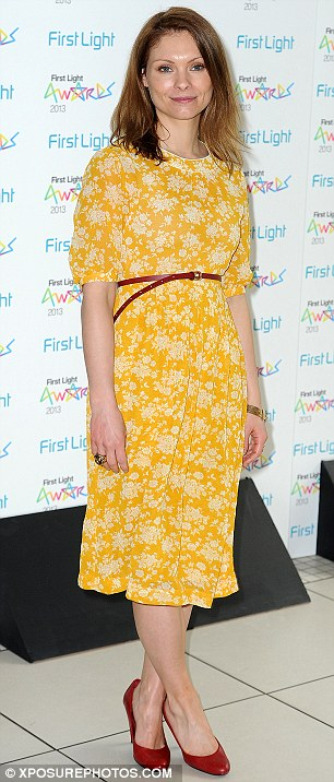 Effortless elegance: The 33-year-old actress looked pretty as a picture in her belted cornflower yellow floral dress