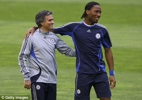 The good times: Mourinho and Drogba enjoyed successful spells at Chelsea