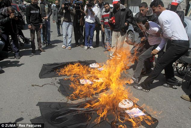 Hateful: Palestinians burned effigies to protest the American President's arrival