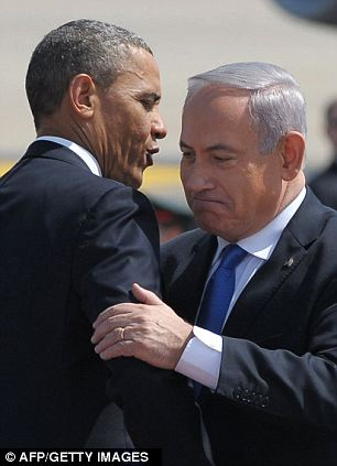 Bring it in: Obama gives big hugs to both Peres (left) and Netanyahu (right)