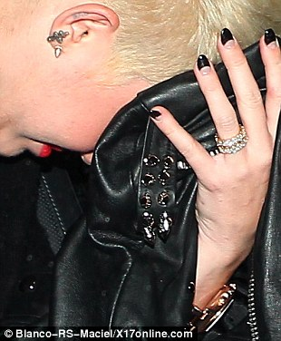 Not helping: The singer did nothing to help stop the rumour mill when she went out partying sans her engagement ring on March 6