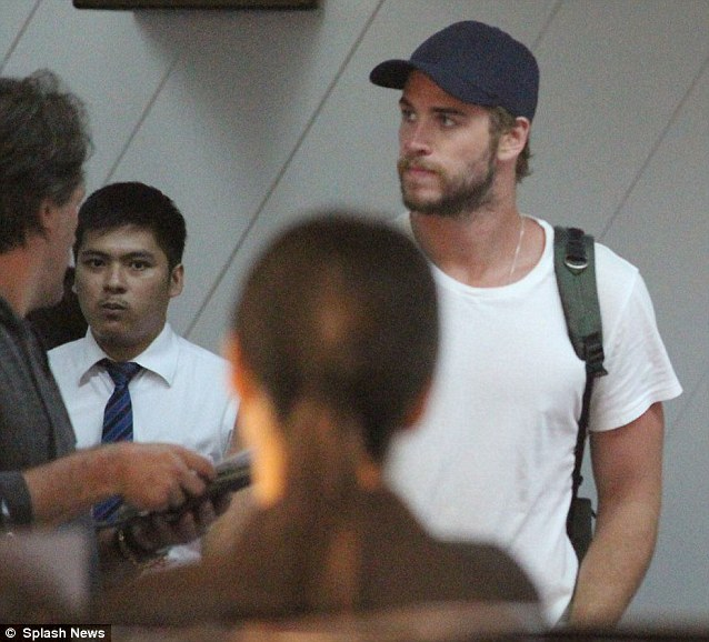 Still on the other side of the world: The singer's fiance Liam Hemsworth was seen jetting out of Manila in the Philippines on Tuesday