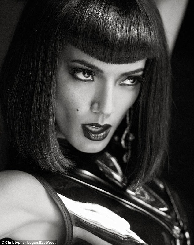 Flawless: The model looked gorgeous with dark lips and black rimmed eyes, her fringe framing her striking features