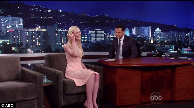 Attack of the giggles: Elle was in high spirits and laughed through the interview