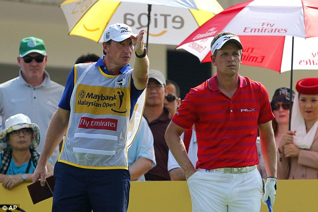 Up against it: Luke Donald made a miserable start at the Malaysian Open in Kuala Lumpur