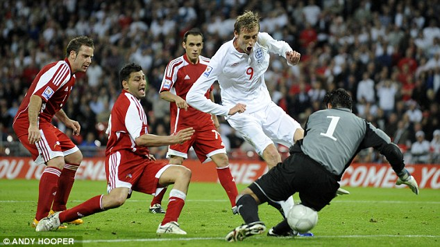 Six of the best: Peter Crouch completes the scoring for England against Andorra