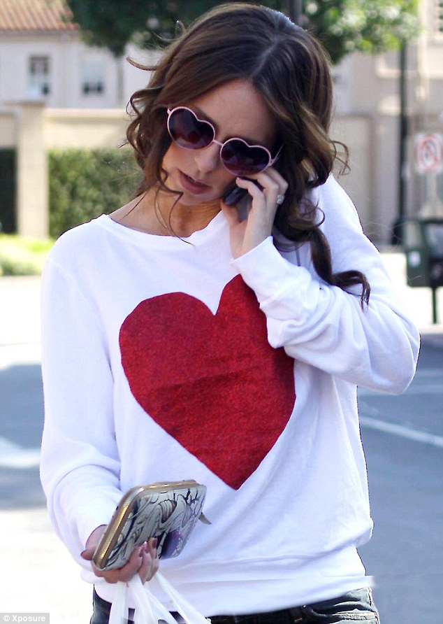 On trend: The actress wore a fashionable heart top and sunglasses
