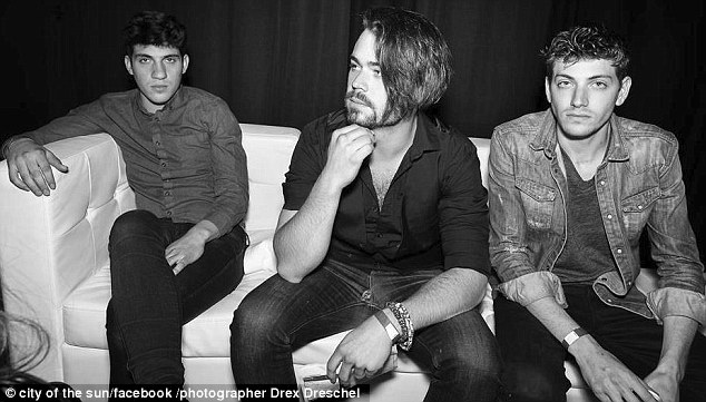 Mean and moody: Avi (far right) sits with his bandmembers for a promo shot