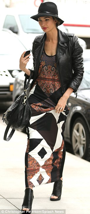 Double vision: Lily Aldridge stepped out in New York City on Thursday in the same Givenchy scarf print maxi dress worn by Kim Kardashian on February 27