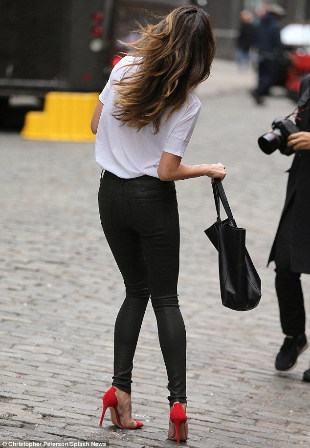 Blowing up: Lily appeared to be in the middle of a photoshoot on the neighbourhood's cobblestone streets