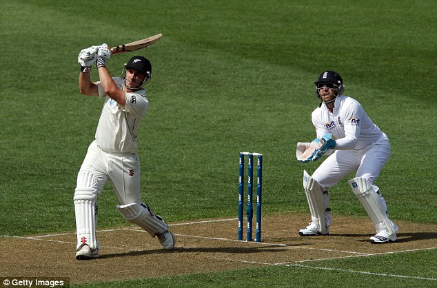 Up and over: Rutherford launches Panesar back over his head for six