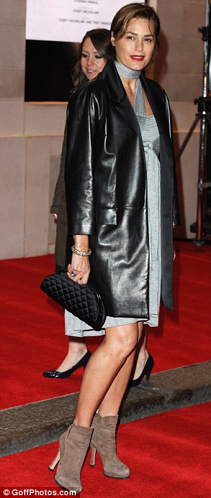 Model behaviour: Yasmin Le Bon wore a grey dress and leather-look jacket with a pair of ankle boots