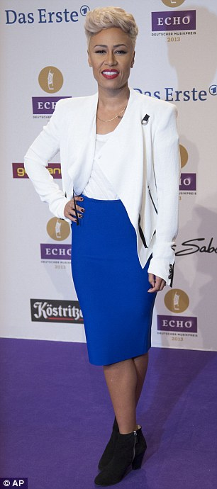Androgynous: Carla Bruni Sarkozy wore a black trouser suit, while Scottish singer Emeli Sande wore a white blazer and blue pencil skirt