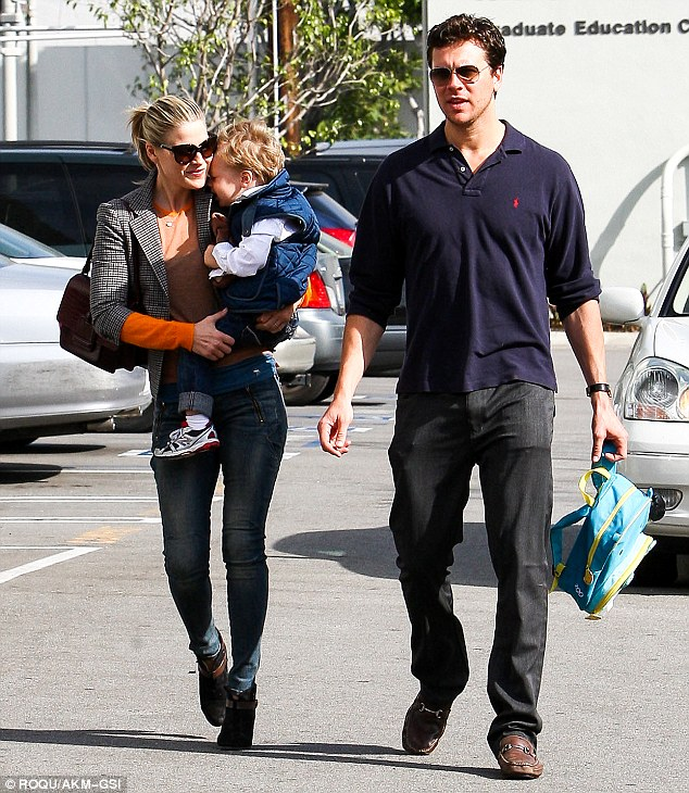 Doting dad: Ali's hubby Hayes MacArthur was also along for the trip