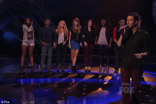 Support group: The finalists stood behind Paul as he sang