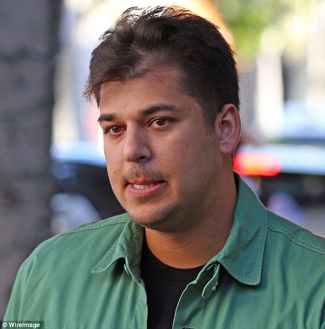 Shameless plug: Rob Kardashian took to Twitter on Wednesday to promote a hair growth supplement, pictured sporting a small bald patch in March in LA