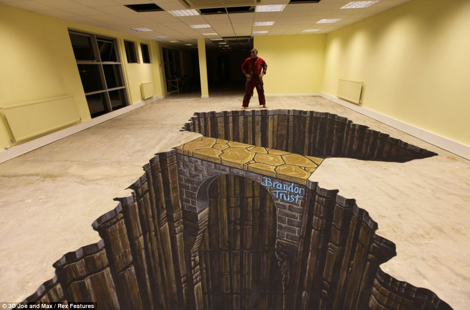 This 3D Street artwork of a bridge across a deep canyon was created for the charity Brandon Trust which helps people with learning disabilities