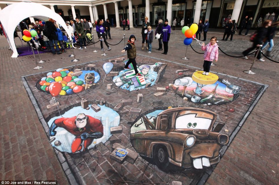 Just for fun: Disney Pixar characters including Buzz Lightyear featured in a 3D street artwork displayed in Covent Garden, London, to launch the new X-box game Kinect
