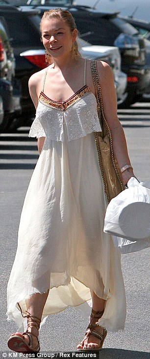 Laid-back style: The 30-year-old was bohemian chic in the cream chiffon dress, which featured red-patterned lining at the chest and spaghetti straps
