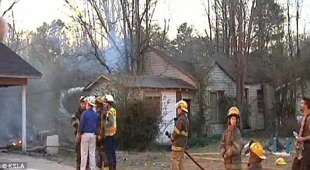 Bad luck: Firefighters struggled to contain the blaze as one side of a neighboring home burned, as well