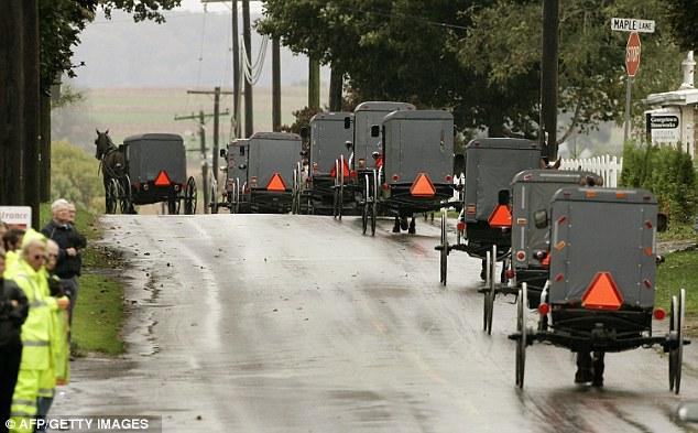 Funeral procession: The community was devastated by the shootings in 2006