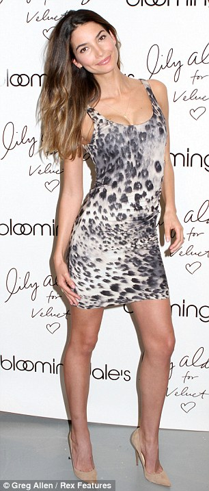 Flaunting what she's got: Lily was snapped that evening wearing a short animal print dress at the Velvet By Graham Spencer collection launch at Bloomingdale's in New York