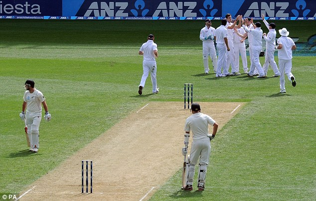 Breakthrough: England celebrate the first wicket of the Test
