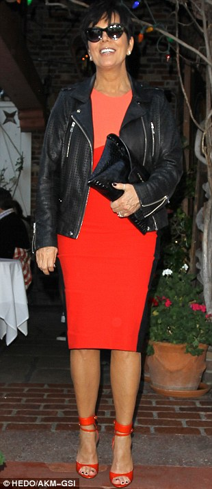 Tangerine dream: Kris Jenner showed off her slim figure in a striking orange and black dress, teamed with matching heels and a black leather jacket