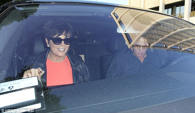 Good spirits: Kris smiled broadly as the couple left the restaurant, while Bruce looked a little down in the dumps