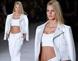 Abs-olutely fabulous! Erin Heatherton shows off her taut stomach and enviable curves in a sexy white crop top