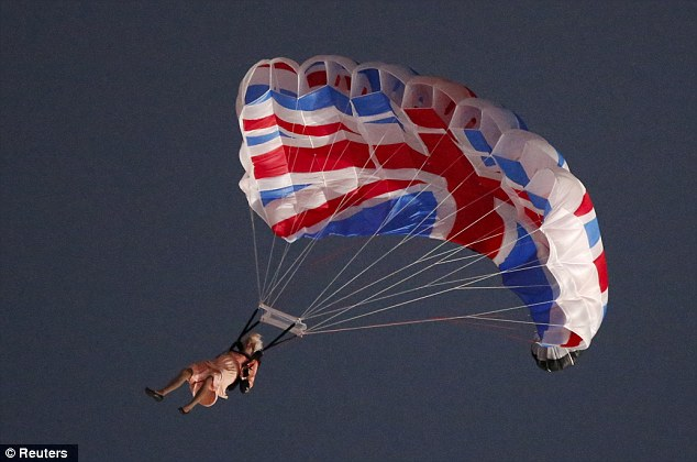 A performer playing the role of the Queen parachutes from a helicopter during the opening ceremony of the London 2012 Olympic Games. He and his artistic team sent a 'script' to Buckingham Palace in the hope Queen would agree to a surprise appearance