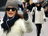 Make Love, Not War! Rachel Weisz does hippy chic in shaggy coat as she flashes the peace sign after a gym session