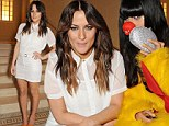 Well it does say 'served chilled': Caroline Flack looks ready for summer in her sheer white blouse and mini at Baileys party