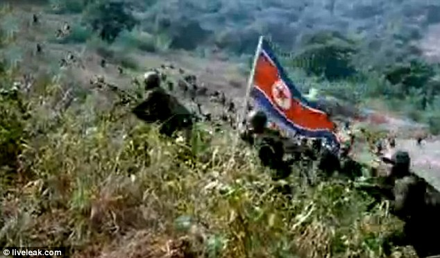 Scores of North Korean soldiers are seen streaming over hillsides bearing banners as they take South Korea