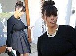 Where's the baby bump? Pregnant Kim Kardashian headed to a meeting in Beverly Hills, California on Wednesday