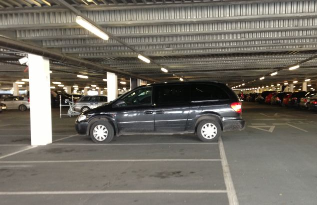 A Chrysler badly parked in a multi-storey car park
